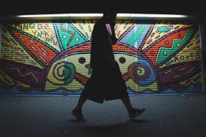 Walking in front of Mural
